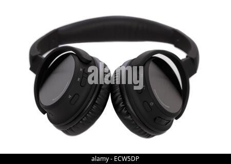 Bluetooth Headphones over white background - Stock Image