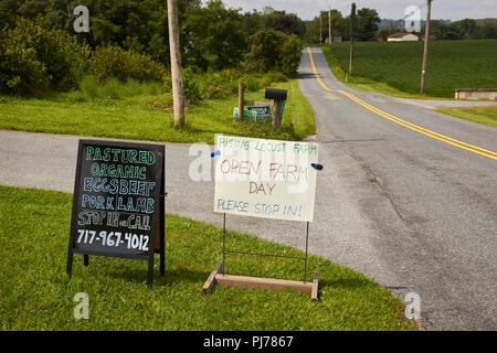 sign announcing Open Farm Day at Rising Locust Farm, a permaculture farm in Elizabethtown, Lancaster County, Pennsylvania, USA - Stock Image