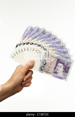 verticalFan of Twenty Pound Notes with Hand - Stock Image