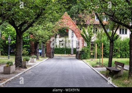 Holy Family Church, Berlin-Lichterfelde, arched brick entrance to church garden - Stock Image