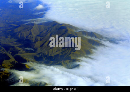 View of Caucasus mountains from airplane, Armenia - Stock Image