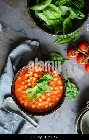Delicious vegetarian Moroccan chickpea soup in a bowl - Stock Image