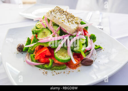 Greek salad with fresh vegetables, feta cheese and olives, Greece traditional cuisine. - Stock Image