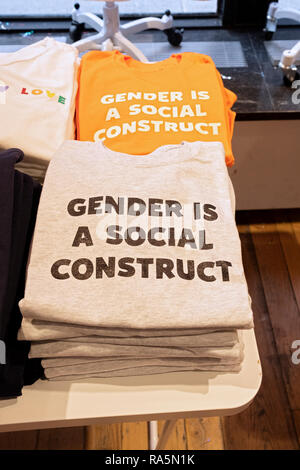 Unisex GENDER IS A SOCIAL CONSTRUCT tee shirts for sale at PHLUID, the world's first gender-free store on Broadway in Greenwich Village, Manhattan, NY - Stock Image