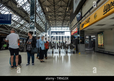 Ticket barriers at Reading Railway Station, a security measure and barrier to free entry, - Stock Image