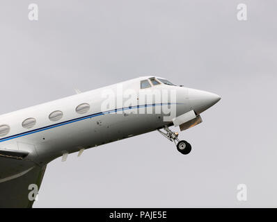 nose of Grumman G-1159 Gulfstream 2 / II climbing out after take-off with undercarriage retracting - Stock Image