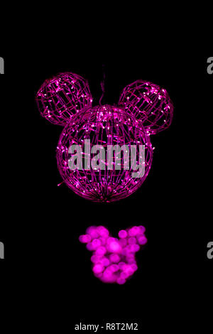 Orchard Road Christmas lights in Singapore, with a Disney theme, pink and Mickey Mouse ears. - Stock Image