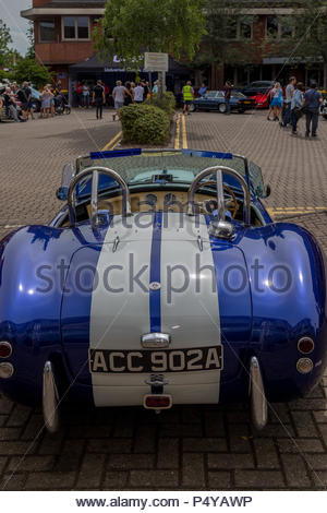 Heritage motor vehicles on show in Fleet, Hampshire. Rear view of an AC Cobra. - Stock Image