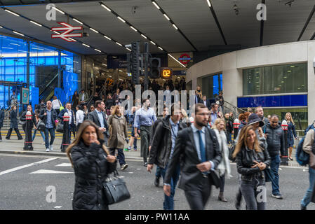 Crowd of commuters leaving Cannon Street railway station, City of London, England, UK - Stock Image