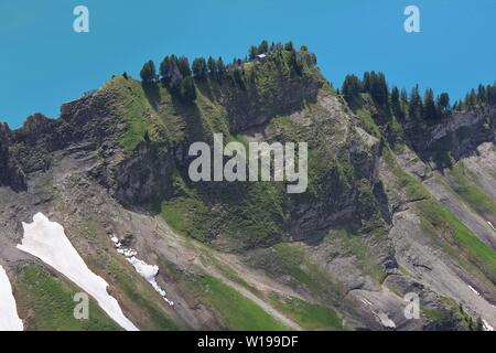 Mountain Ridge and turquoise water of Lake Brienz. View from Mount Brienzer Rothorn, Switzerland. - Stock Image