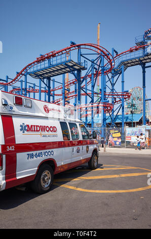 New York, USA - July 02, 2018: An ambulance parked in front of Coney Island amusement park. - Stock Image