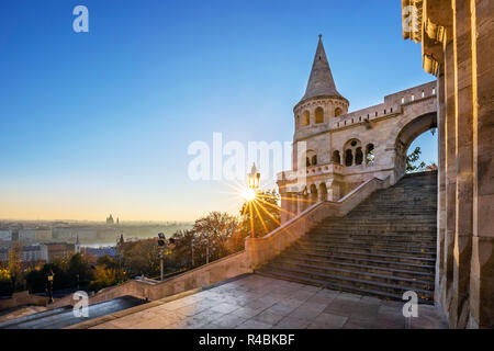 Budapest, Hungary - Entrance steps and the south tower of the Fisherman's Bastion (Halaszbastya) at sunrise and clear blue sky - Stock Image