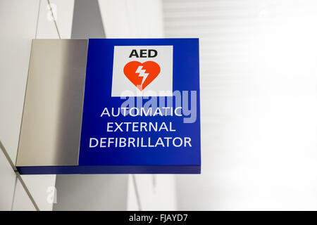 AED Automated External Defibrillator Sign at an airport. - Stock Image