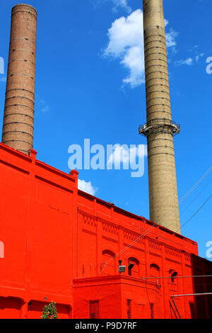 NEW YORK, NY - JUNE 26: Bright red post-industrial building in Greenwood neighborhood of Sunset Park, Brooklyn on JUNE 26th, 2017 in New York, USA. (P - Stock Image
