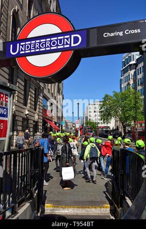 London, England, UK. Schoolchildren passing Charing Cross Underground station in the Strand - Stock Image