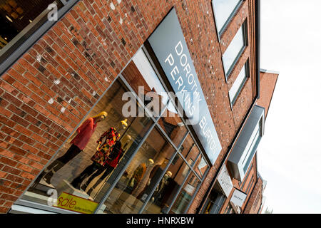 Dorothy Perkins ladies clothes store Burton menswear shop UK England sign signs outside shop front exterior modles - Stock Image