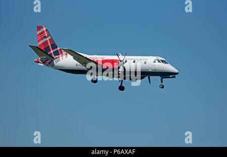 Loganair Saab 340 G-LGNC taking off from Inverness Airport on it's daily flight to Stornoway in the Outer Hebrides. - Stock Image