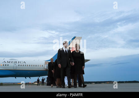 U.S. Secretary of Defense James N. Mattis walks with Cindy McCain, wife of Senator John McCain after greeting her at the steps of an 89th Airlift Wing C-32 aircraft upon arrival at Joint Base Andrews, Md., Aug. 30, 2018. The aircraft arrived with the remains of McCain and his family. The former senator's remains are en route to lie in state in the U.S. Capitol Rotunda. The 89th Airlift Wing provides global Special Air Mission airlift, logistics, aerial port and communications for the president, vice president, cabinet members, combatant commanders and other senior military and elected leaders  - Stock Image