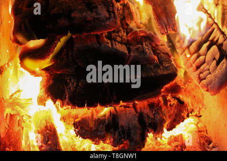 Hot burning wood in a stone oven - Stock Image