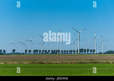 Wind Turbines in front of blue sky - Stock Image