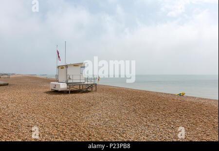 Lifeguards in Hastings Beach, Hastings, East Sussex, England , UK - Stock Image