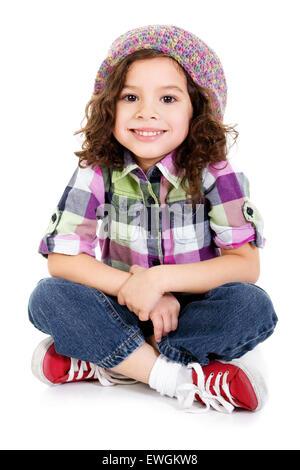 Stock image of happy female preschool age child sitting over white background - Stock Image
