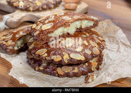 Sweet dessert for autumn season, Dutch filled cookies with marzipan and almonds close up - Stock Image