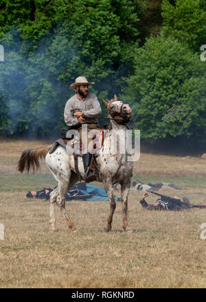 Duncan Mills, CA - July 14, 2018: Confederate soldier and horse at a Civil war reenactment. The Civil War Days is one of the largest reenactment event - Stock Image
