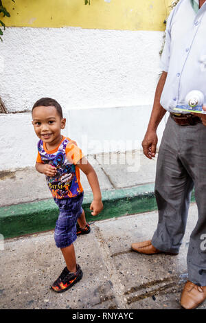 Cartagena Colombia Old Walled City Center centre Getsemani Hispanic boy father resident - Stock Image