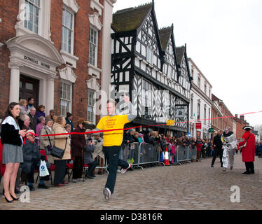 Alexander Kitchenhaum winning the Mens Pancake Race which is part of the traditional Shrovetide Fair in Bore Street - Stock Image
