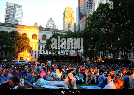 NEW YORK, NY - JUNE 26: People gathered for summer night movie during Bryant Park Summer Film Festival, Manhattan on JUNE 26th, 2017 in New York, USA. - Stock Image