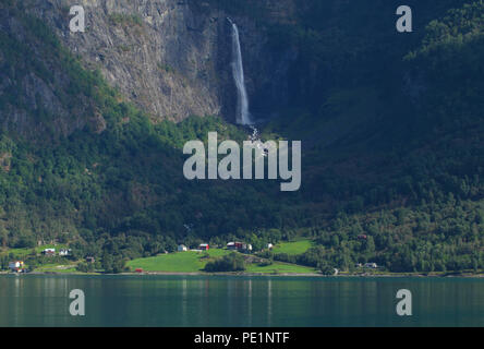 Skjolden, Norway - 6 August 2018: A water fall on one of the jagged mountin peaks of the Sogenfjorden Fjord on the vicinity of the village of Skjolden in the fjords of Norway on 7 August 2018. The village is set at the inner end of Sogenfjorden, the world's longest fjord and the deepest in Norway with its sheer valley walls and jagged mountain peaks. Photo: David Mbiyu - Stock Image