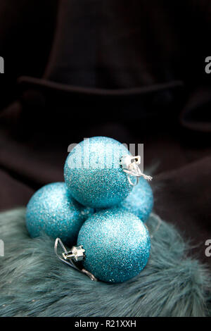 Sorrow or sad blue christmas with sparkly ornaments - Stock Image