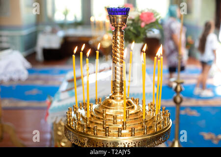 Candle holder in church during wedding - Stock Image