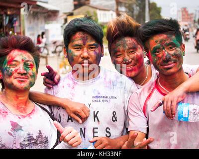 Nepali youths covered with coloured powder after celebrating the Hindu festival Holi in Pokhara, Nepal - Stock Image