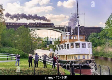 Duchess of Sutherland steam locomotive pictured crossing the river Weaver at Frodsham junction, Sutton Weaver on the 2019 Great Britain Railtour. - Stock Image