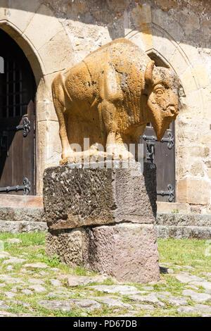 Santillana, Spain - 8th July 2018: Sandstone sculpture of a bull. - Stock Image