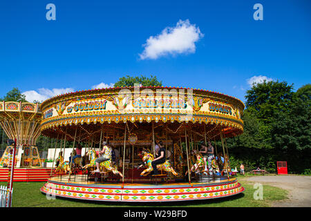 90th Kent County Show, Detling, 6th July 2019. A carousel with people enjoying the ride on a hot summers day. - Stock Image