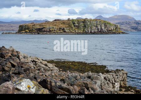 Small rocky island of Eilean Mor on Loch Torridon, Applecross Peninsula, Wester Ross, Highland Region, Scotland - Stock Image