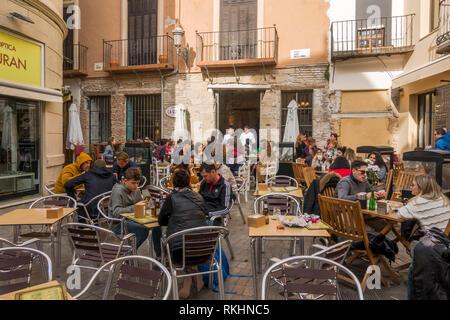 Malaga Spain, People sitting at a Bar terrace, square in Malaga, Andalusia, Spain, Europe - Stock Image