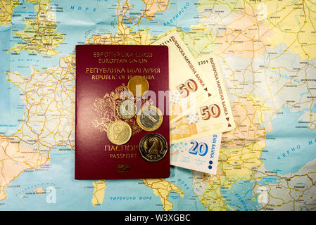 Passport from Bulgaria with money on Europe map background - Stock Image