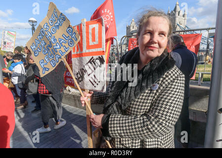 London, UK. 3rd November 2018. A woman holds a placard calling for a ballot over the demolition of homes in Deptford by Lewisham Council. Several hundred people, mainly from London's council estates under threat of demolition by Labour London councils came to a protest outside City Hall called by 'Axe the Housing Act'. The protest called for an end to estate demolitions unless  approved by a ballot of all residents, and for public land to be used to build more council homes rather than being turned over to developers to make huge profits from high-priced flats. Speaker after speaker from estat - Stock Image