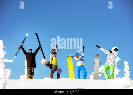 Group happy friends snowboard ski concept - Stock Image