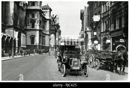 Empty streets of London with one taxi cab and a horse-dawn cart. - Stock Image