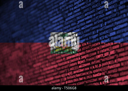Haiti flag  is depicted on the screen with the program code. The concept of modern technology and site development. - Stock Image