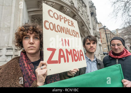 London, UK. 15th January 2019. Foil Vedanta campaigners at the Supreme Court where British mining company Vedanta is appealing High Court and Court of Appeal rulings that 1,826 polluted farmers from Zambia can have their case against the company and its subsidiary Konkola Copper Mines heard in the UK. The farmers say  Konkola Copper Mines have polluted the River Kafue since 2004 with excessive levels of copper, cobalt and manganese causing sickness and deaths, damage to property and loss of income. Peter Marshall/Alamy Live News - Stock Image