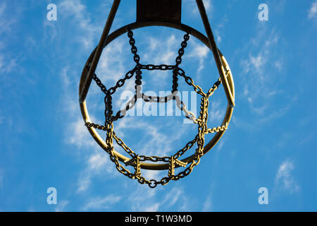 Detail of basketball basket outdoors in blue sky. - Stock Image