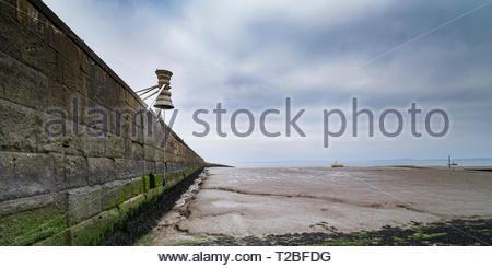 A Time and Tide Bell on the Stone Jetty in Morecambe, Lancashire, UK, installed in March 2019. One of about 12 installations around the coast of UK - Stock Image