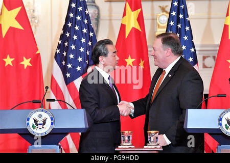 U.S. Secretary of State Mike Pompeo and Chinese State Councilor and Foreign Minister Wang Yi shake hands following their joint press conference at the U.S. Department of State in Washington D.C. on May 23, 2018. - Stock Image