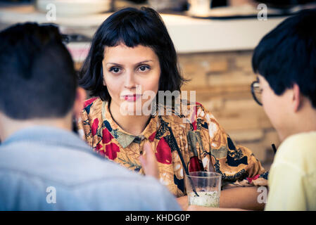 Woman looking at companion - Stock Image
